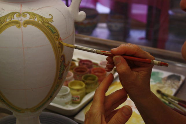 Decoration with a brush of artistic ceramics